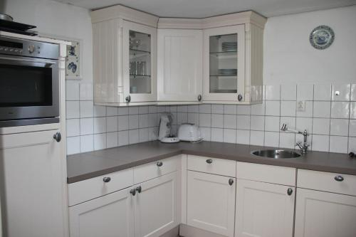 A kitchen or kitchenette at Zandvoort Centre Holiday Homes