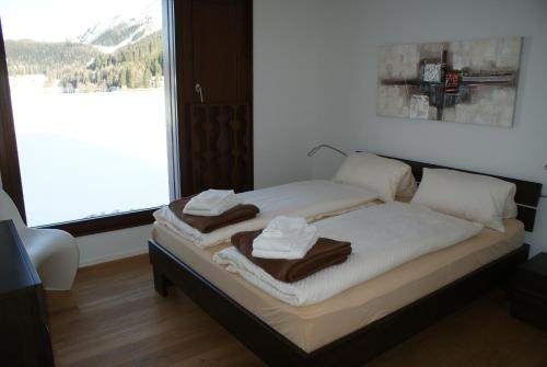 A bed or beds in a room at Loft Seepromenade