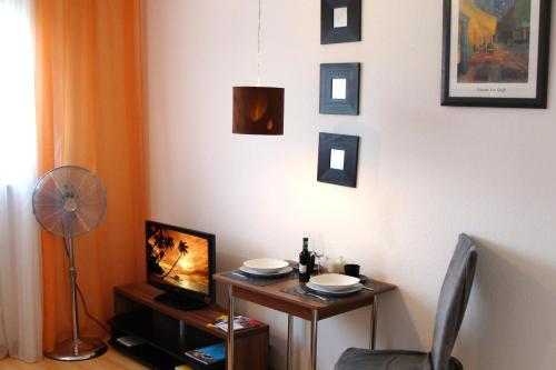 A television and/or entertainment center at City Apartment am Hauptbahnhof