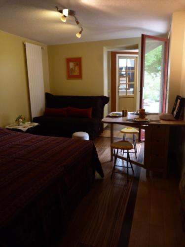 Un ou plusieurs lits dans un hébergement de l'établissement Aux Jardins d'Alice