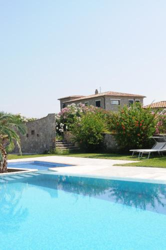 The swimming pool at or near Relais Le Ginestre