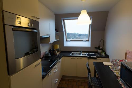 Cuisine ou kitchenette dans l'établissement Duinenzicht II