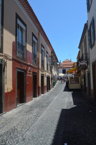 The surrounding neighborhood or a neighborhood close to the guesthouse