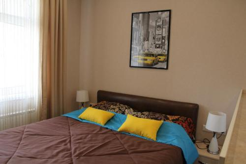 A bed or beds in a room at Rent Apartments Premium Class