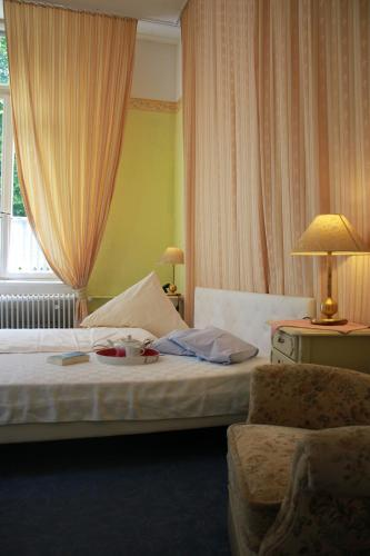 A bed or beds in a room at Hotel Waldfriede