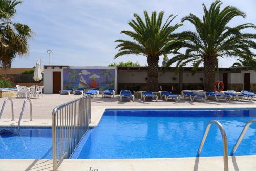 The swimming pool at or near Apartamentos Zodiac