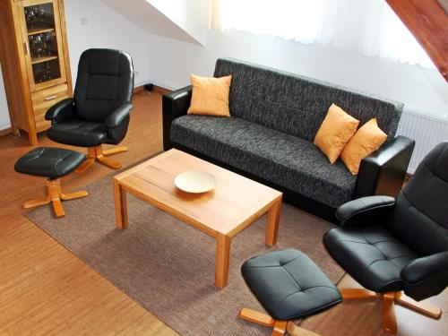A seating area at Ferienwohnung Teltow