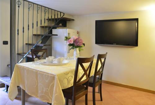 A television and/or entertainment center at Gemelli Holidays