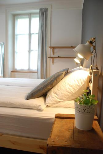 A bed or beds in a room at The Bed + Breakfast