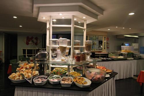 Un restaurant sau alt loc unde se poate mânca la Gonzaga Flat (Technotel Ltda.)