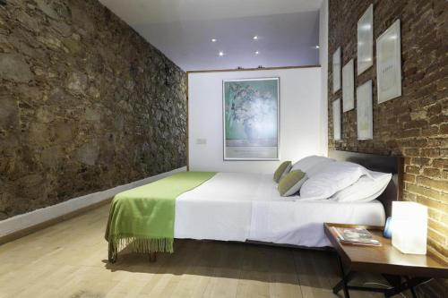 A bed or beds in a room at SuperLoft Barcelona Center