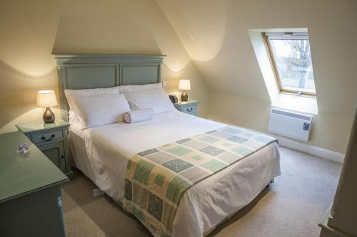 A bed or beds in a room at East Clare Golf Village By Diamond Resorts