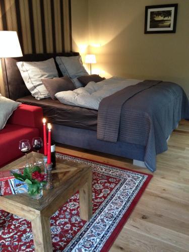 Uma cama ou camas num quarto em Haus Bikowsee