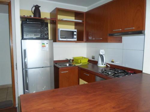 Una cocina o zona de cocina en Suites San Isidro