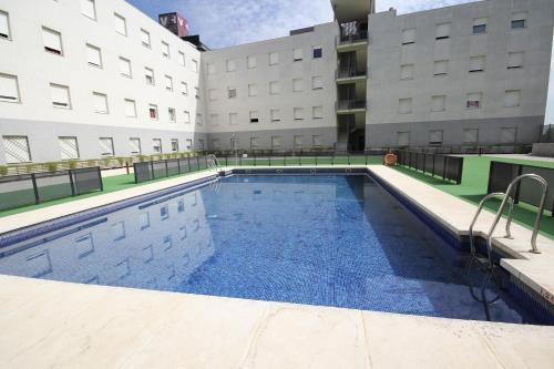 The swimming pool at or near Apartamentos Vértice Sevilla Aljarafe