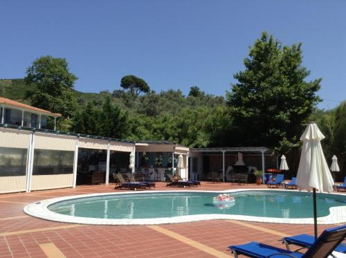 The swimming pool at or near Marialena Village