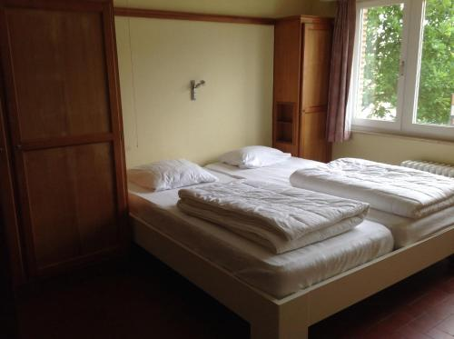 A bed or beds in a room at Villa Maran