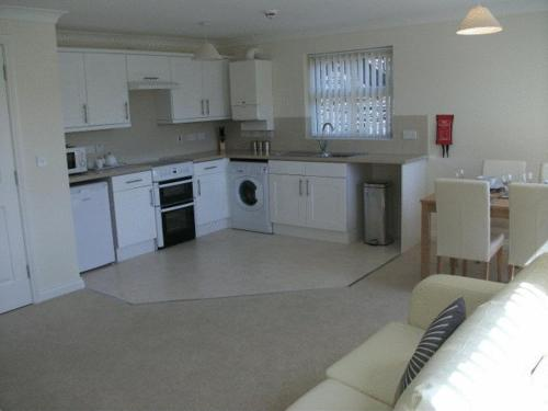 A kitchen or kitchenette at Falcon's Nest Self Catering Apartments