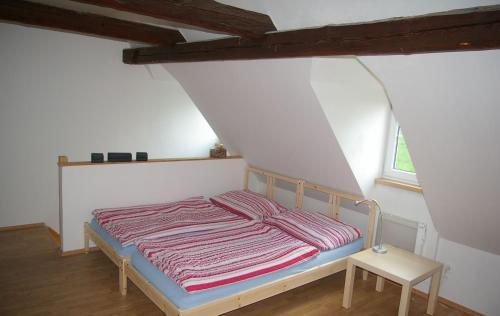 Postel nebo postele na pokoji v ubytování Apartmány Růžová