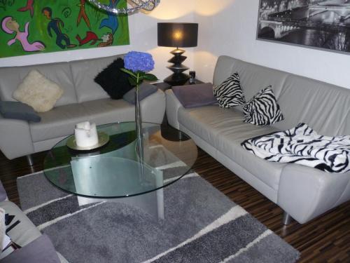 Ein Sitzbereich in der Unterkunft Ambiente
