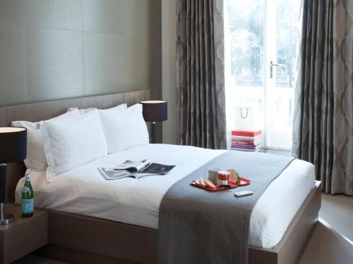 Cama o camas de una habitación en 130 Queen's Gate Apartments