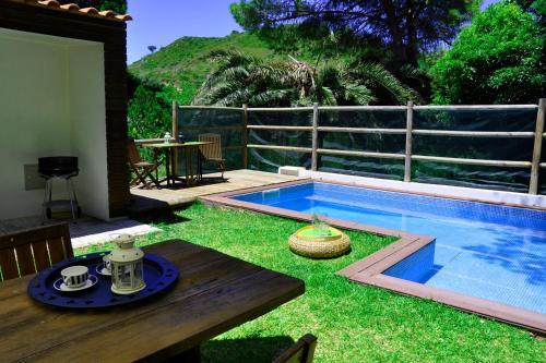 The swimming pool at or near Villa Santa Barbara by be@home