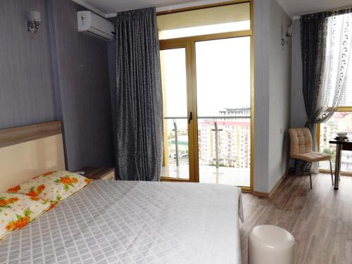 A bed or beds in a room at Orbi Plaza Apartment