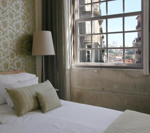 A bed or beds in a room at Sao Domingos by Oporto Tourist Apartments