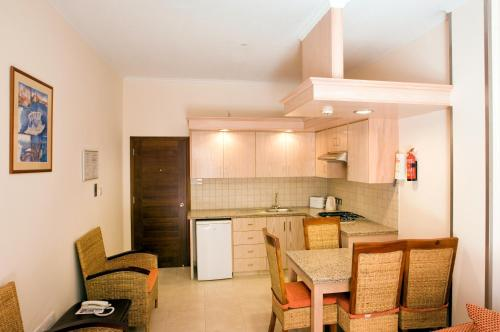 A kitchen or kitchenette at Senator Hotel Apartments