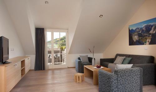 Uma área de estar em Residence Innichen - San Candido