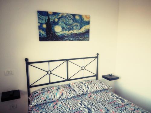 A bed or beds in a room at L'Altra Modica Locazione Turistica