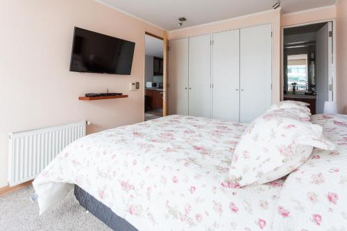 Cama o camas de una habitación en Livinnest Apartments en Manquehue
