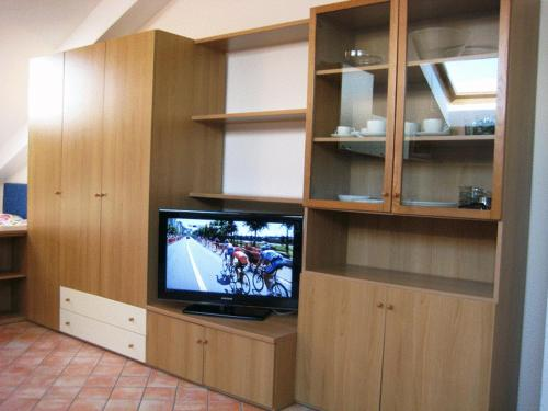 A television and/or entertainment center at Casa Vacanze Spino