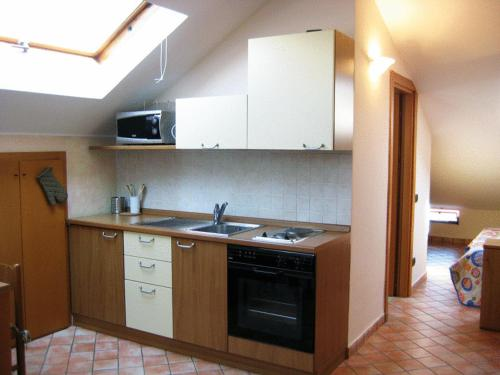 A kitchen or kitchenette at Casa Vacanze Spino