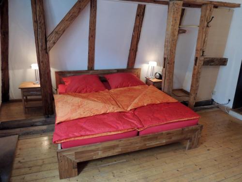 A bed or beds in a room at Ferienwohnungen Rockefeller Zentrum Bamberg