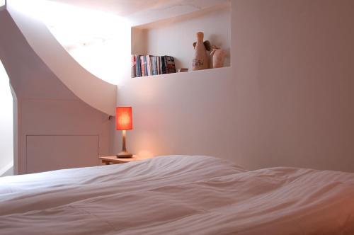 Postel nebo postele na pokoji v ubytování V27 Apartment