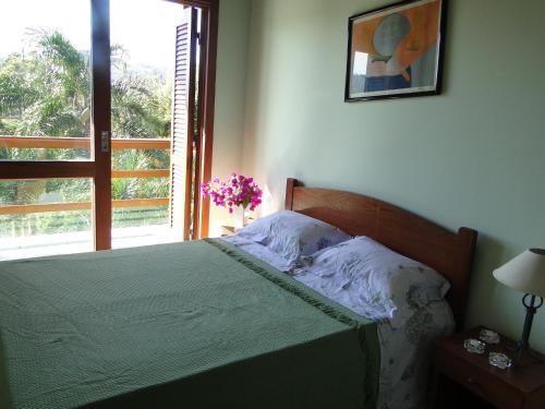 Cama o camas de una habitación en Casa Lago Neves II
