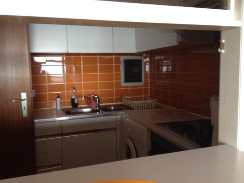 Küche/Küchenzeile in der Unterkunft Apartment Nord Vrie 8D