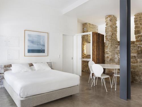 Llit o llits en una habitació de Hello Lisbon Castelo Apartments