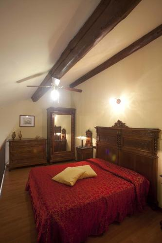 A bed or beds in a room at Agriturismo Il Bove
