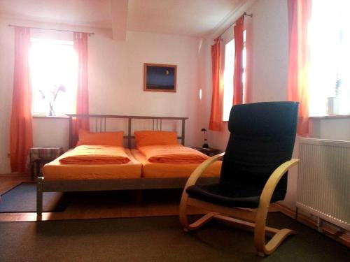A bed or beds in a room at Ferienwohnung Wenzlaff