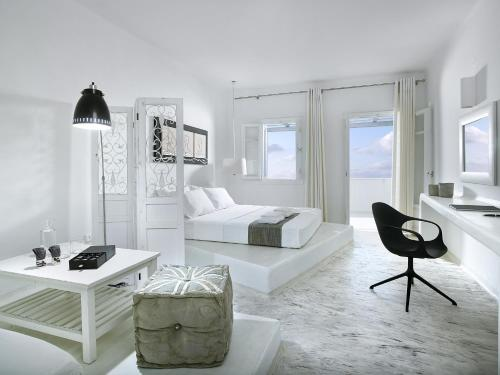 A seating area at Artemis Deluxe Rooms
