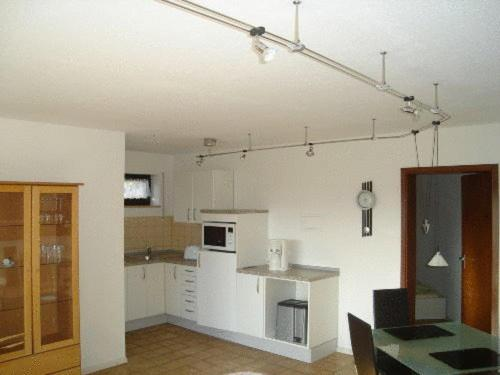 A kitchen or kitchenette at Ferienwohnung Erika