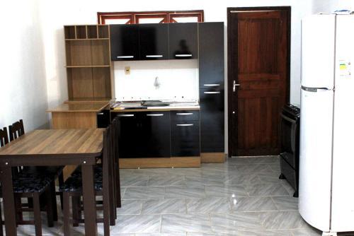 Una cocina o zona de cocina en Casa Cachoeira do Bom Jesus