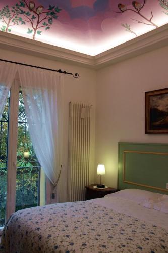 Letto o letti in una camera di La Corte Del Cavaliere Bed & Breakfast
