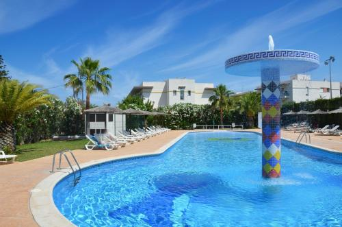 The swimming pool at or near Aparthotel Club La Sirena