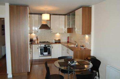 A kitchen or kitchenette at Langley Apartments - Portland Street