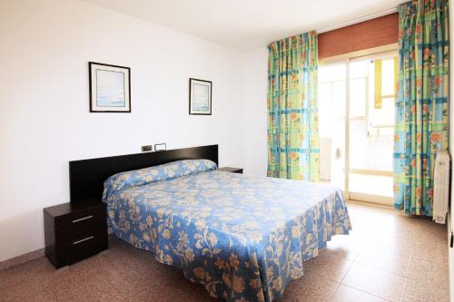 Кровать или кровати в номере Apartamentos Indasol
