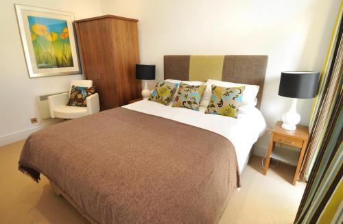 Ein Bett oder Betten in einem Zimmer der Unterkunft Highland Apartments by Mansley