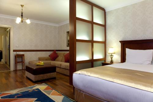 A bed or beds in a room at Sultanahmet Suites